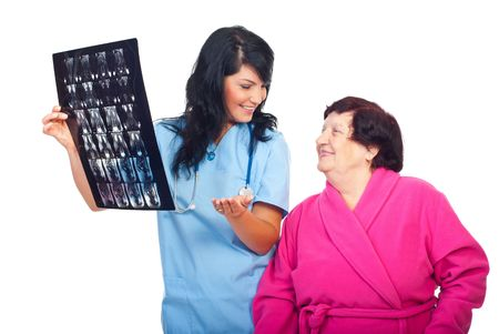 Doctor woman communicates to elder patient the   good results of  MRI scans and both are satisfied isolated on white background photo