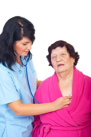 Doctor woman assessing elderly patient isolated on white background photo