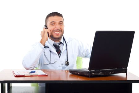 Smiling doctor having a happy conversation on phone mobile in his office isolated on white background photo