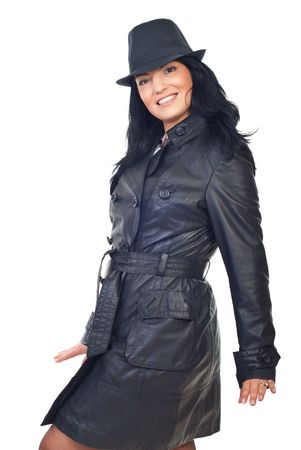 long shots: Beautiful model woman posing in black leather jacket and hat isolated on white background