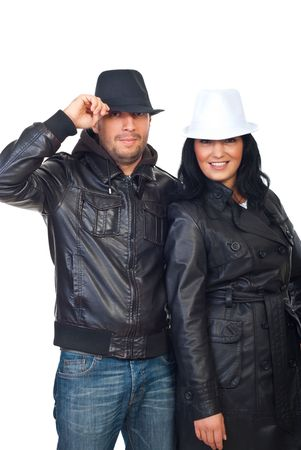 Couple wearing leather jackets and hats isolated on white background photo