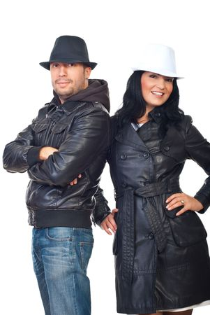 Fashionable couple wearig leather jackets and hats isolated on white background photo