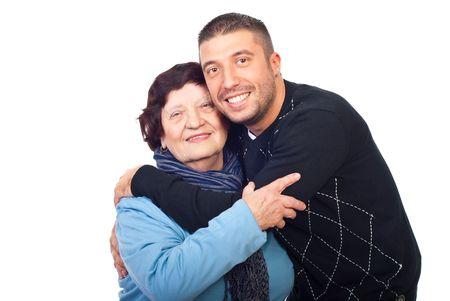 Happy grandson hugging her grandma isolated on white background photo