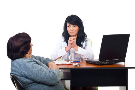 Serious physician woman listening her elderly patient problems and being worried photo
