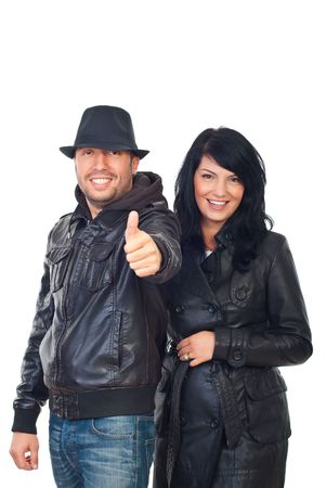 Laughing cool couple in leather jackets giving thumbs up isolated on white background photo