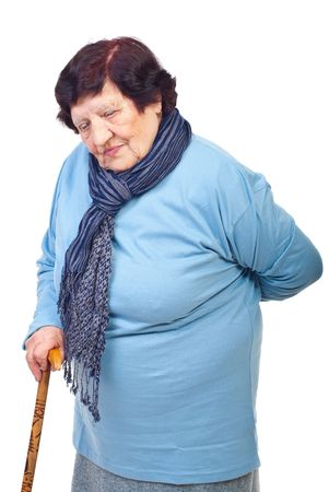 Elderly woman having back in pain, holding a cane  and looking down isolated on white background Stock Photo - 8042105