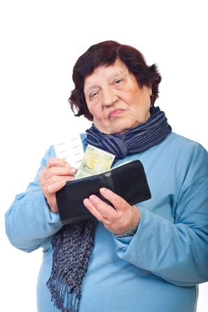 Sad elderly woman giving last penny from wallet on medicines isolated on white background Stock Photo - 8042104