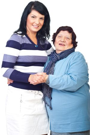 octogenarian: Portrait of happy grandma with her granddaughter holding hands isolated on white background