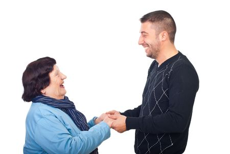 octogenarian: Grandson having conversation with grandma , holding  her hands and laughing together isolated on white background
