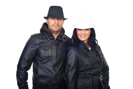 Cool couple in leather jackets and hats isolated on white background photo