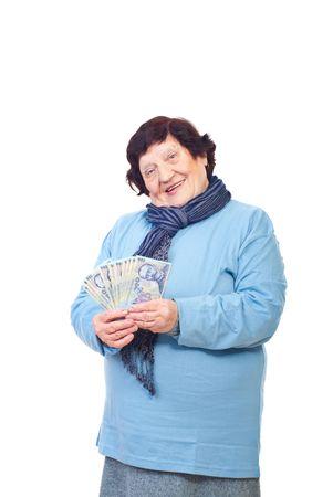 Happy senior woman holding Romanian cash isolated on white background photo