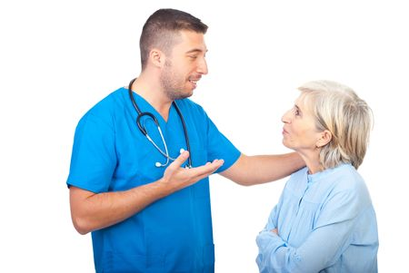 Caring doctor giving explanation to a senior woman patient  isolated on white background Stock Photo - 8042113