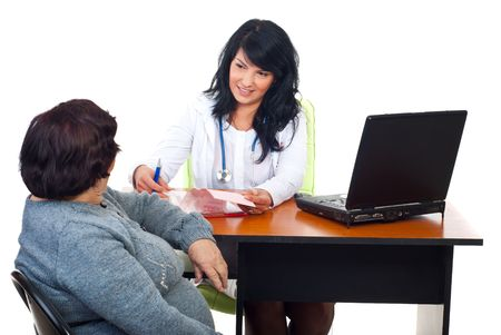 Doctor woman having conversation with elderly patient in office and preparing  to write prescription Stock Photo - 8042129