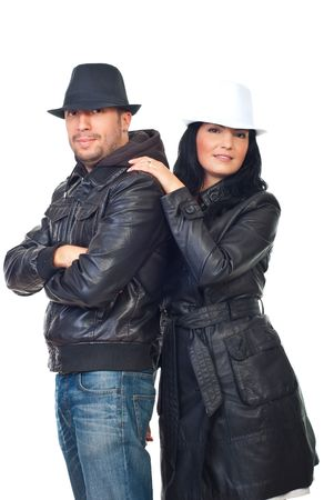 Beautiful couple of models in leather jackets and hats isolated on white background photo