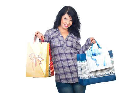 Happy smiling woman holding shopping bags isolated on white background Stock Photo - 8042142