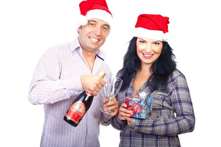 Cheerful couple celebrate Christmas and holding  bottle of Champagne,glasses and a gift isolated on white background photo