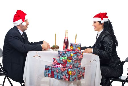 Happy couple with Santa hats having conversation at Christmas dinner table Stock Photo - 8042165