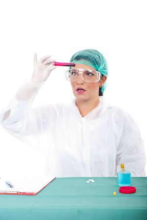Surprised woman in laboratory examine blood in a tube photo