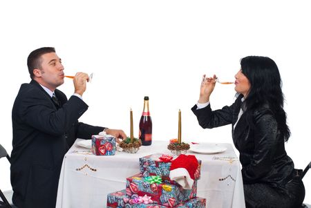 Elegant couple in festive clothes driking champagne and sitting together at Christmas table  photo