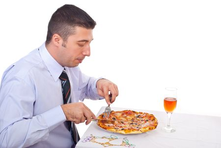 Businessman eating pizza in a business break  and sitting at table photo