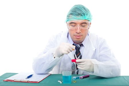 Scientist man making experiments in laboratory and holding a pipette with liquid photo
