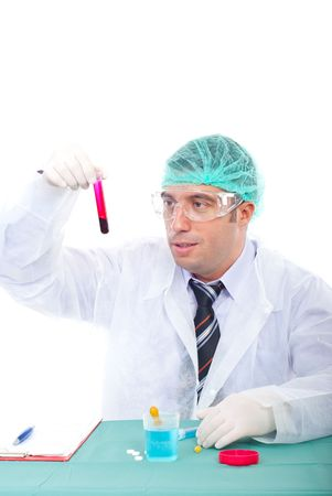 Laboratory man examine blood tube and sitting at table  photo