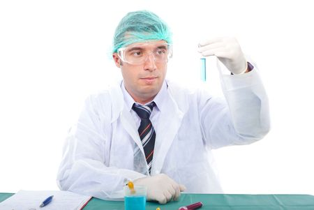 Scientist man examine tube with blue liquid  in laboratorry photo