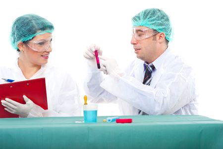 Team of two scientists people examine blood tube .Man pointing on tube and woman writing in clipboard  photo