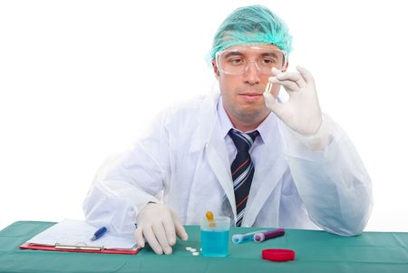 Laboratory man making tests and examine an oil capsule with Omega-3 photo