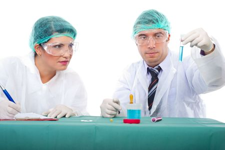 Chemist man holding tube with blue liquid and student woman taking notes  in a laboratory,isolated on white background photo