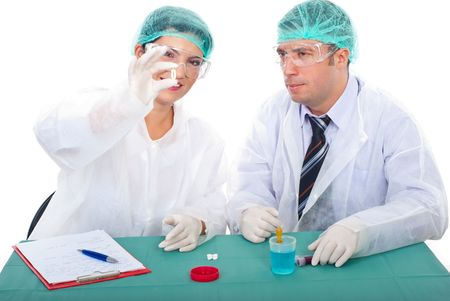 Pharmacist teamwork studying oil capsule with Omega-3 and having conversation together in laboratory photo