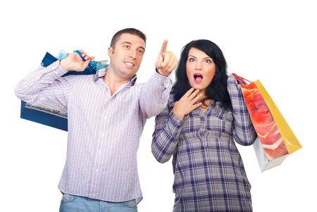 Amazed couple at shopping,man pointing up to promotions and woman being very surprised isolated on white background photo