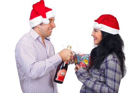 Laughing Christmas couple standing face to face holding champagne and gift and having funny conversation isolated on white background photo
