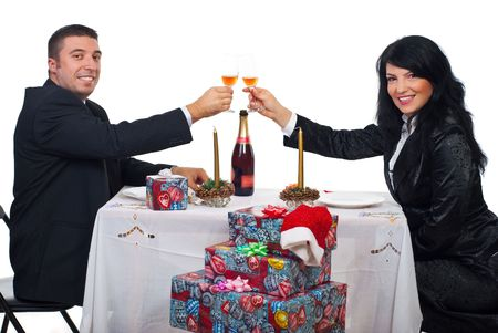 Happy elegant couple toast with champagne at Christmas dinner and looking you Stock Photo - 8042217