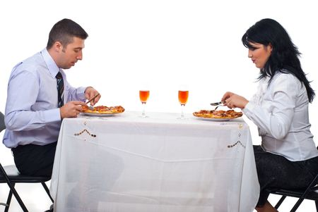 Two business people having lunch and eating pizza at table