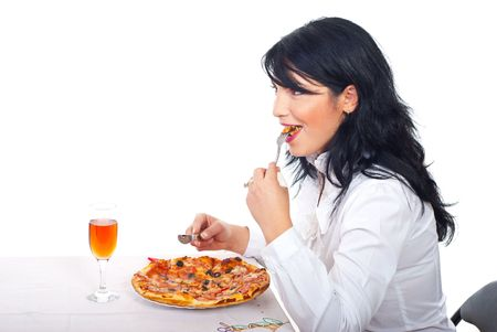 Smiling business woman having lunch and eating pizza in business break from office photo