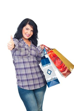 Happy sauccessful woman holding shopping bags and giving thumbs up isolated on white background Stock Photo - 8103096