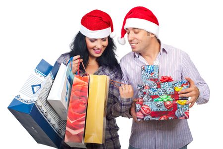 Happy couple at shopping for Christmas  looking in bags and  being satisfied of what they bought isolated on white background Stock Photo - 8103109