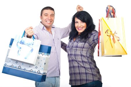 Successful couple holding shopping bags and cheerfing isolated on white background photo
