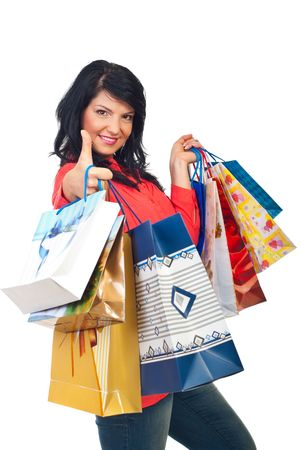 Successful woman with shopping bags giving thumb up and smiling isolated on white background Stock Photo - 8103116