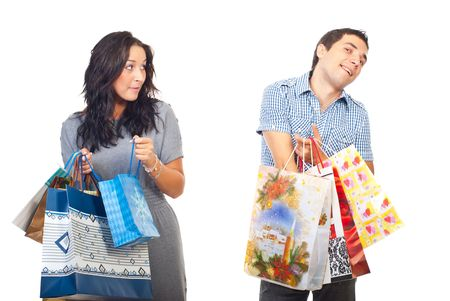 Envy woman looking sideways to a man who searching in his shopping bags isolated on white background photo