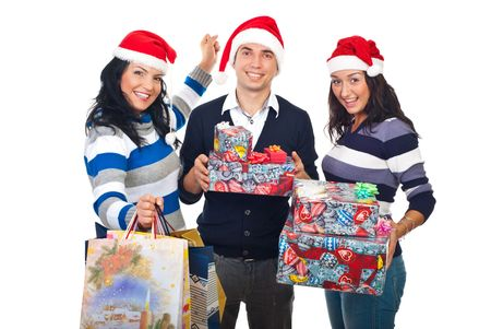 Happy three friends wearing Santa hats and holding shopping bags and Christmas presents isolated on white background photo