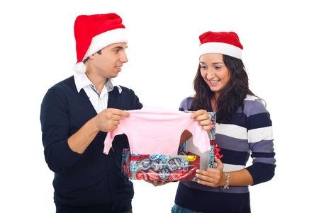 Happy couple  open a gift and receiving surprising news at Christmas by  found a baby cloth in box,they will be parents  photo