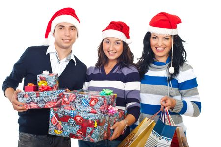 Happy  group of friends with Santa hats  standing in a row and holding Christmas gifts,bags and boxes  isolated on white background photo
