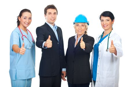 Four different workers giving thumbs up and standing in a row isolated on white background photo