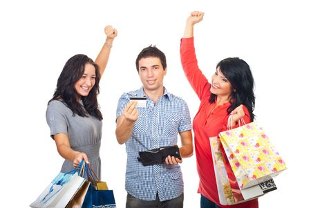purchased: Two women with shopping bags cheering while a man showing a credit card and smile isolated  on white background Stock Photo