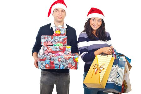 purchased: Happy young couple holding purchased gifts isolated on white background
