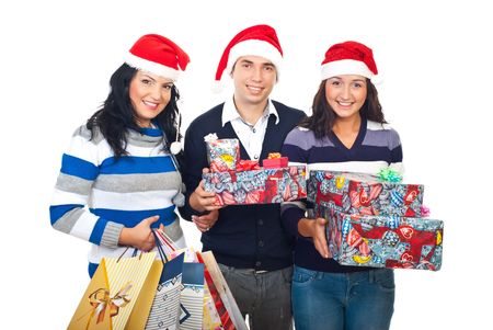 Cheerful friends wearing santa hats and holding presents for Christmas isolated on white background photo