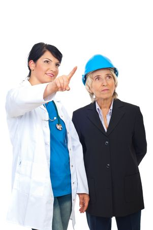 Doctor woman pointing up  and showing something to a  senior architect isolated on white background photo
