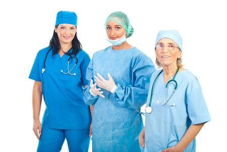 Smiling team of three different surgeons women isolated on white background photo